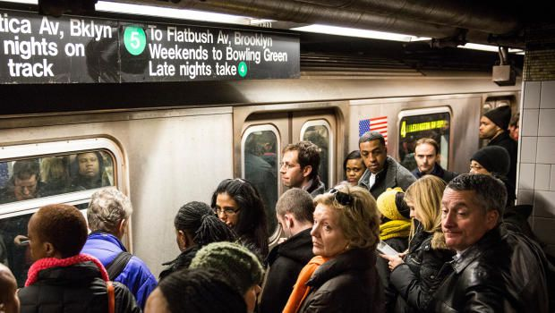 NEW YORK, NY - MARCH 10: Commuters wait to board a New York City subway car at Grand Central Terminal during evening rush hour on March 10, 2014 in New York City. New statistics revealed that public transit ridership is at its highest since 1956. (Photo by Andrew Burton/Getty Images)